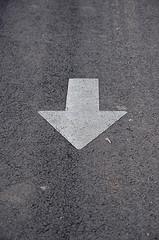 White arrow on gray tarmac