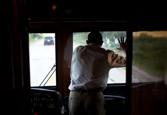 President Barack Obama waves to people in Decorah, Iowa, Aug. 15, 2011, during a three-day bus tour in the Midwest focusing on ways to grow the economy.
