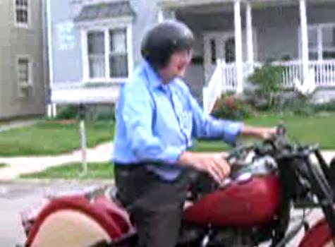 Older man riding motorcycle