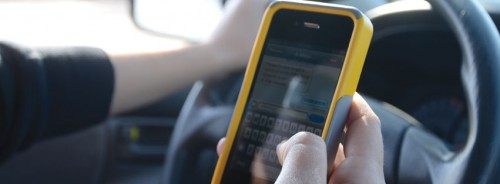 Texting while driving. Image courtesy Texas A&M Transportation Institute