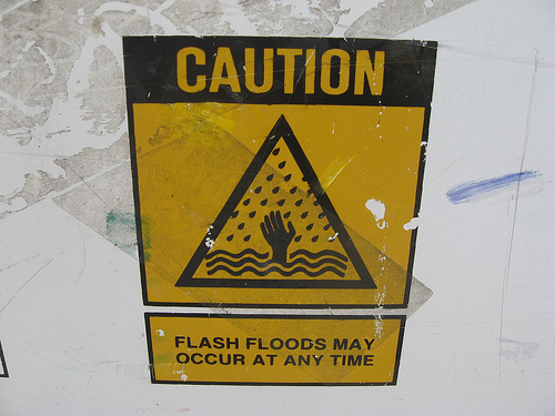 sign warning of flash floods