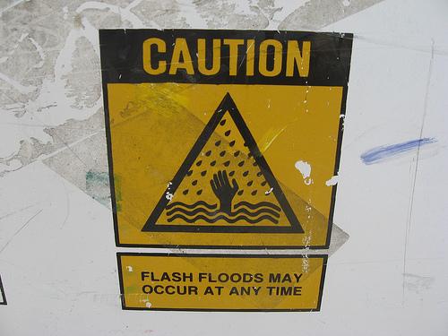 sign warning of flash floods