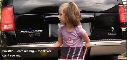 Small child behind a vehicle; Image courtesy kidsandcars.org