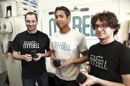 The three members of the MyBell team holding MyBell units