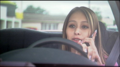 Teen talking on phone while driving. Image courtesy TeenDriverSource.org, The Children's Hospital of Philadelphia | Research Institute