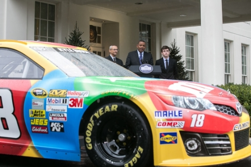 DOT Secretary Anthony Foxx (center) with Counselor to President Obama John Podesta and racecar driver Ryan Blaney, at the White House on Tuesday, December 9, 2014