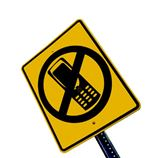 Road sign that bans cell phone use. Courtesy National Safety Council