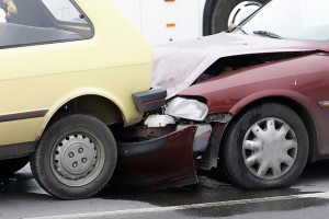 Two cars damaged by rear-collision crash