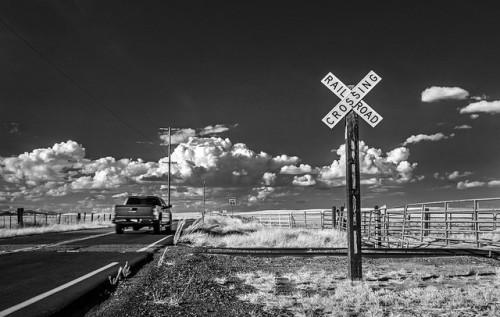 Pickup truck passes a rural railroad crossing.