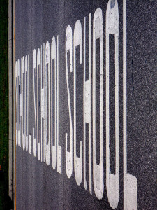 """SCHOOL SCHOOL SCHOOL"" stenciled on roadway"