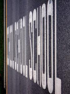 """""""SCHOOL SCHOOL SCHOOL"""" stenciled on roadway"""